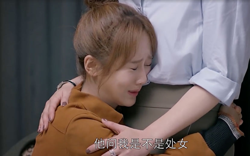 A still frame from the second season of the TV drama 'Ode to Joy' shows the character Qiu Yingying crying after her boyfriend broke up with her. The subtitle reads, 'He asked me if I was a virgin.'