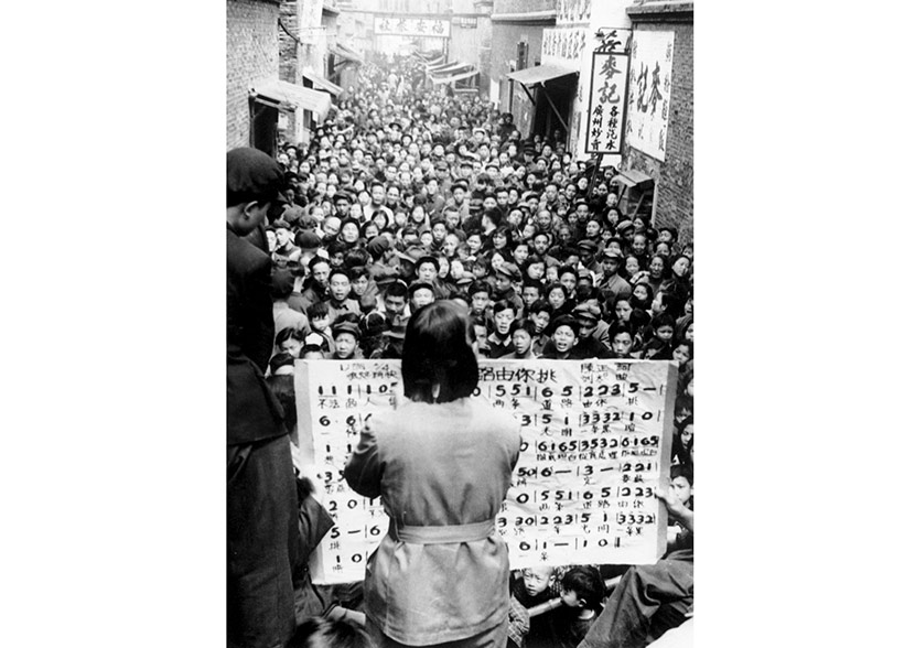 Members of a propaganda unit lead choral song in a residential lane, Shanghai, 1951-1952. Courtesy of 'Old Photos'