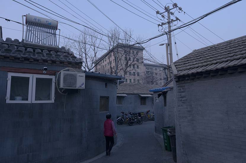 The Fusuijing Building towers over the surrounding 'hutong' houses, in Beijing, March 22, 2018. Kevin Schoenmakers/Sixth Tone