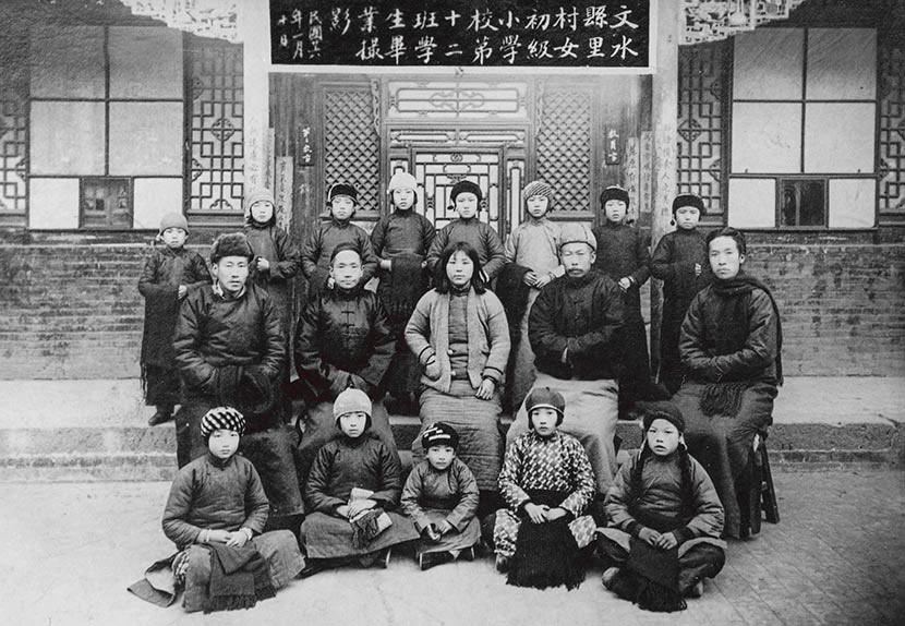 Teachers and students pose for a group photo at a girls' primary school in Li Village, Wenshui County, Shanxi province, January 1937. Courtesy of 'Old Photos'