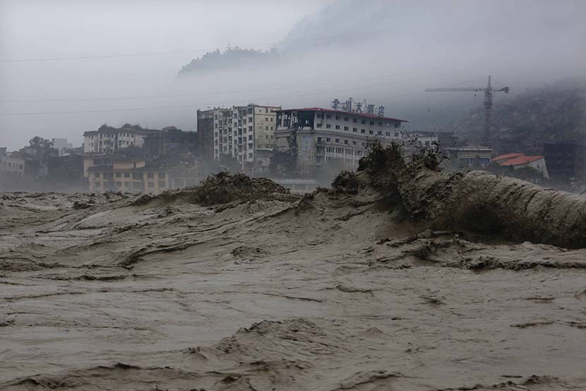 Heavy flooding hits the old town of Beichuan Qiang Autonomous County, Sichuan province, July 9, 2013. By Yang Weihua