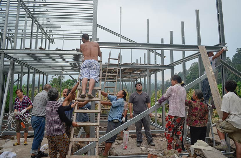 Villagers build a house with an earthquake-resistant light steel frame in Baishu Village, Sichuan province, Aug. 10, 2013. Courtesy of the One Foundation