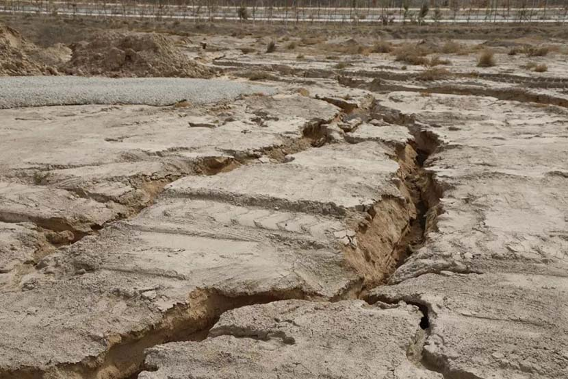 Dry, cracked earth can be seen at the abandoned construction site in Gaolan County, Gansu province, April 2018. From the WeChat public account of China Real Estate Business