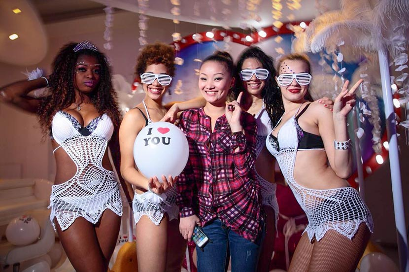 Wang Feng (middle) poses with a group of go-go dancers whom she manages in Changsha, Hunan province, 2013. Courtesy of Wang Feng