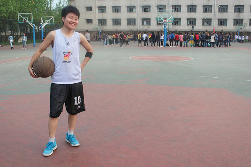 Meng Yu poses for a photo on the basketball court in Wuhan, Hubei province, 2012. Courtesy of Meng Yu