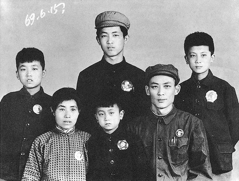 A family poses for a photo wearing buttons emblazoned with Chairman Mao's portrait in 1969. Courtesy of 'Old Photos'