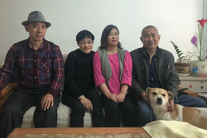 From right to left: Wang Guitong, Wang's wife, Chen Yumei, and Chen's husband pose for a photo in Qingdao, Shandong province, April 27, 2018. Wang Lianzhang/Sixth Tone