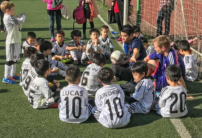 Fang Wenfei coaches young soccer players in Shanghai, 2016. Courtesy of Fang Wenfei