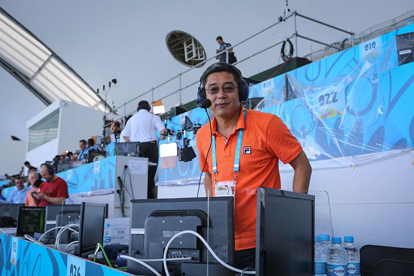 Veteran sports commentator Liu Jianhong poses for a photo during the 2014 World Cup in Rio de Janeiro, June 25, 2014. Courtesy of Liu Jianhong