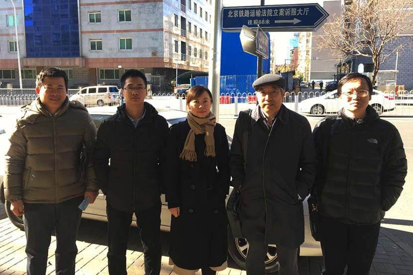 Yu Liying (middle), the plaintiff's lawyer, poses for a photo with professor Cui Xiaobo (second from right) from Capital Medical University and Yang Jie (first from right), a researcher at the Chinese Center for Disease Control and Prevention, outside the court before the trial in Beijing, December 2017. Courtesy of Yu