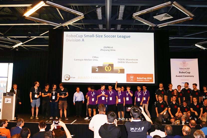 Zhejiang University's team receives their award during RoboCup 2018, a soccer competition for robots held in Montreal, June 22, 2018. Courtesy of ZJUNlict