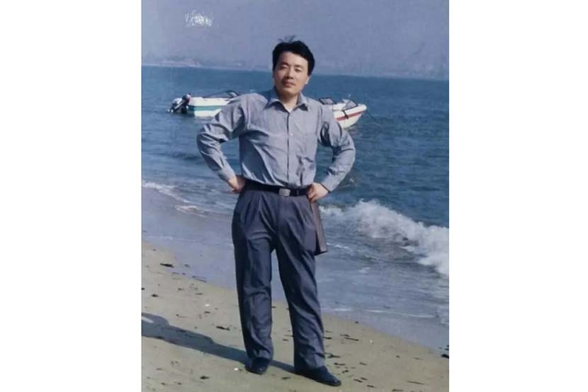 Zhang Wenqi poses for a photo by the sea. Courtesy of Zhang Wenqi