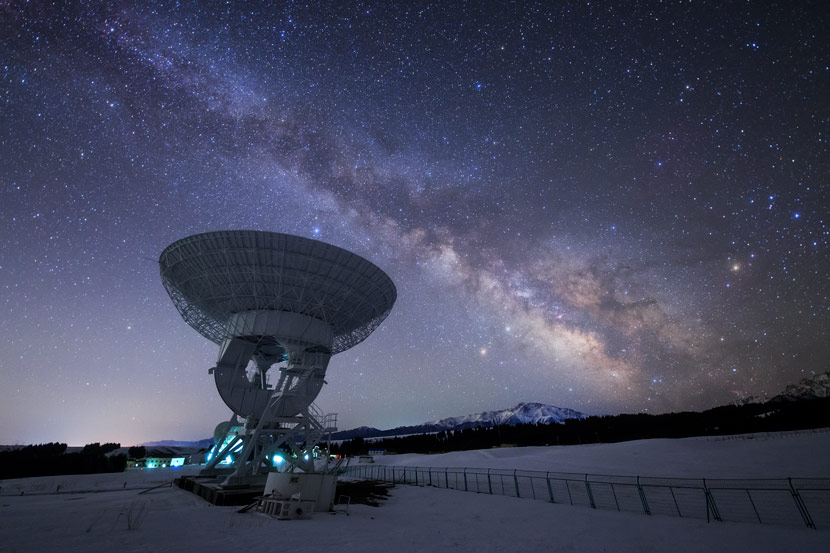 A radio telescope points toward the Milky Way at Xinjiang Astronomical Observatory, Xinjiang Uyghur Autonomous Region, April 12, 2018. Courtesy of Dai Jianfeng