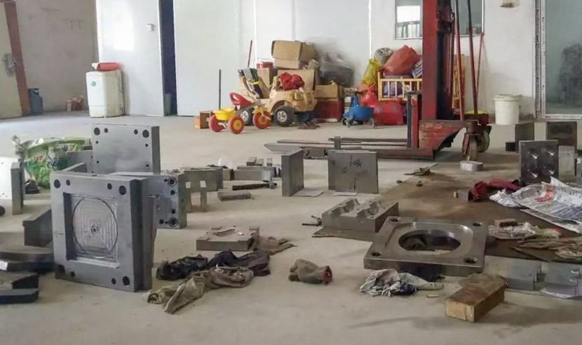 Metal molds clutter the floor of the factory where Liang Chaowei once worked in Shantou, Guangdong province, 2018. Courtesy of Liang Chaowei