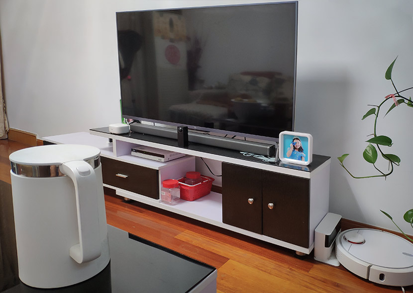 Xiaomi products including a TV, robot vacuum, speaker, and kettle at Hong Jun's home in Shanghai, July 26, 2018. Courtesy of Hong Jun