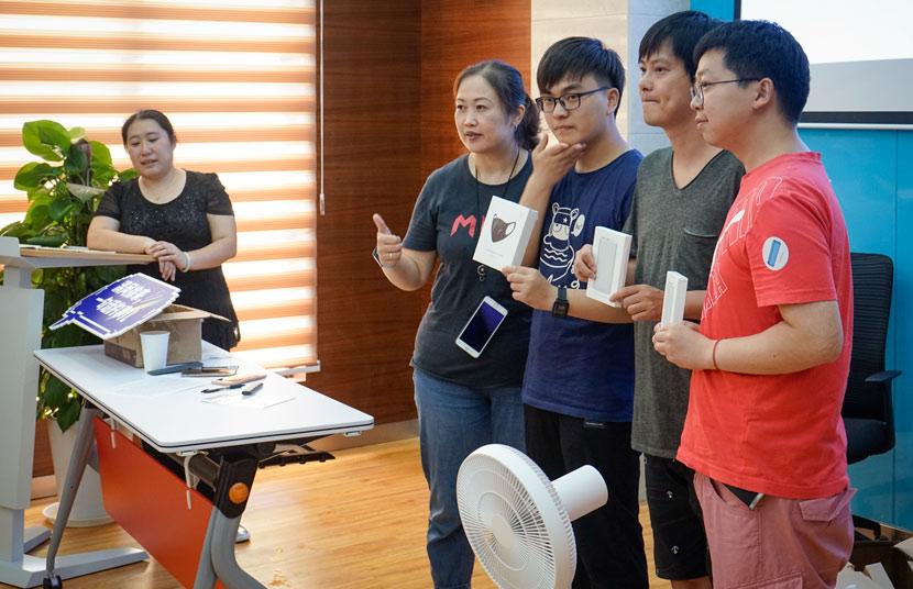 Xiaomi fan club leader Yan Hui (far left) at a product testing event in Shanghai, July 21, 2018. Yu Yongfei for Sixth Tone