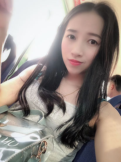 Ye Xiuyan takes a selfie on a bus in Haikou, Hainan province, 2018. Courtesy of Ye Xiuyan