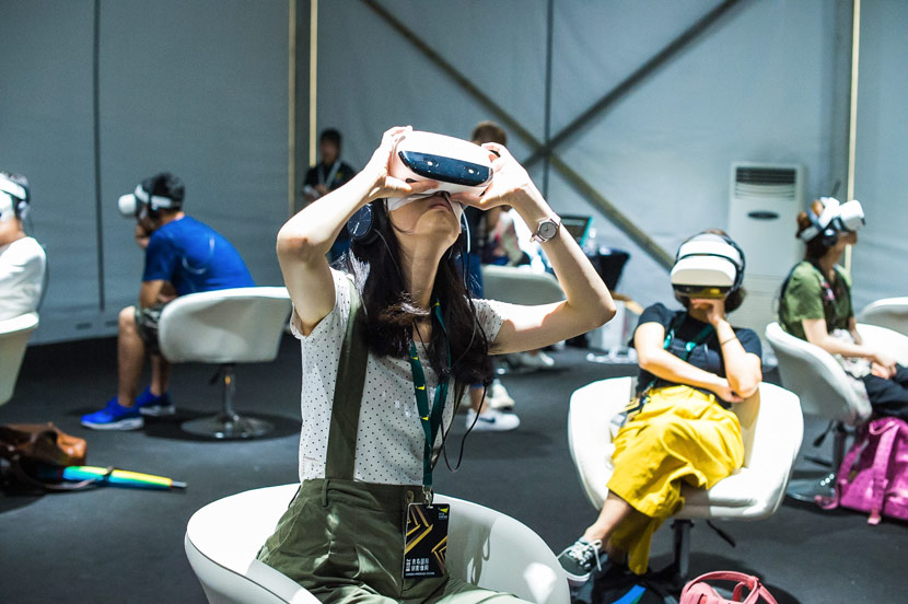 People watch VR videos using headsets during Sandbox Immersive Festival in Qingdao, Shandong province, June 25, 2018. Courtesy of Sandbox Immersive Festival