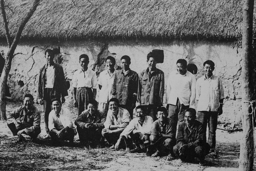 An archive photo depicts a number of men who pioneered the farming reform in Xiaogang during the late 1970s. Courtesy of Yan Hongchang