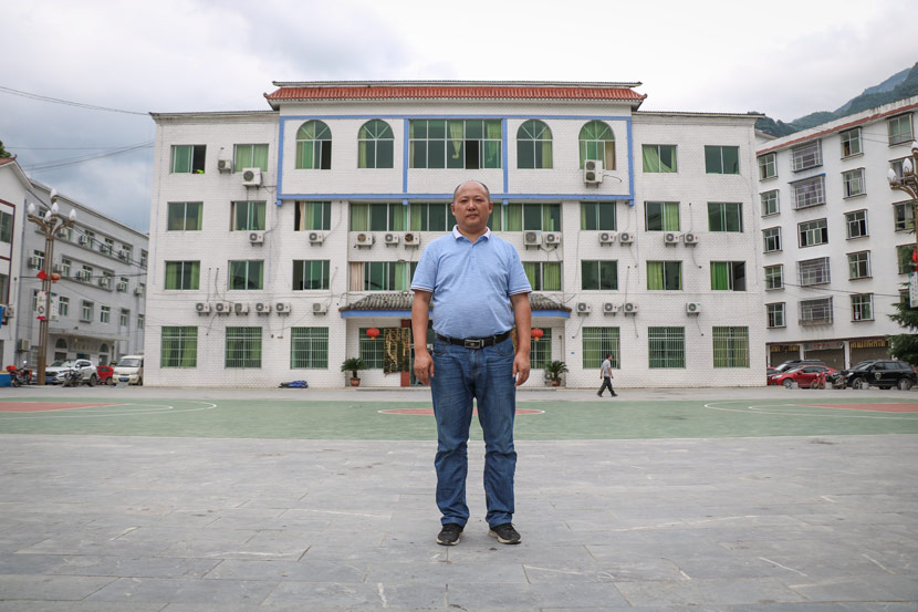 Town Head Li Yusong poses for a photo in front of Sanqiao Town's government building, in Guizhou province, July 2, 2018. Nicole Lim for Sixth Tone