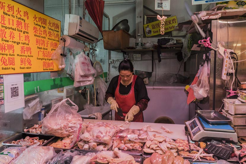 A meat shop at a market in Beijing, May 15, 2016. Jin Xin/VCG
