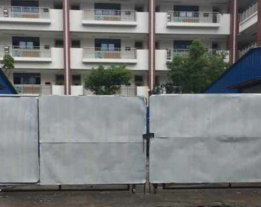 The barrier separating the Lixin and Qinxi sides of the school in Suzhou, Jiangsu province, August 2018. Courtesy of a parent