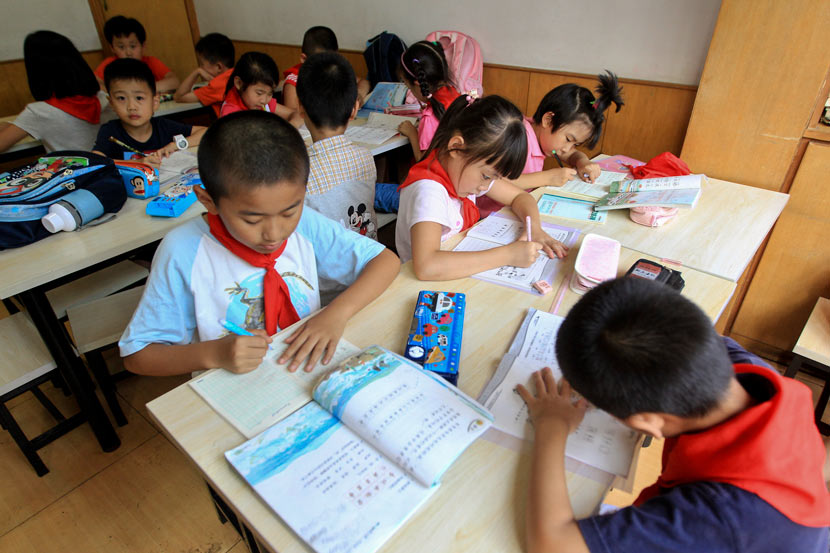 Children study at a paid after-school program in Qingdao, Shandong province, Sept. 6, 2013. IC