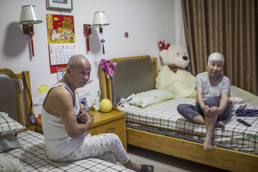 An elderly couple watches TV in their room at Sunshine Home in Hangzhou, Zhejiang province, Sept. 28, 2018. Chen Zhongqiu for Sixth Tone