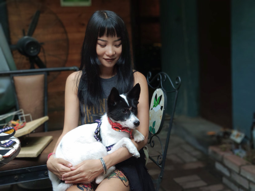 Xing Ruizhi holds her foster dog, Coco, in Jinan, Shandong province, Aug. 31, 2018. Fan Yiying/Sixth Tone