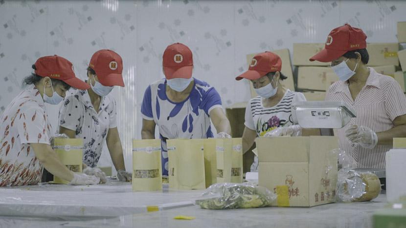 Workers in a warehouse package products sold on Gan Youqin's Taobao shop, Lingshan County, Guangxi Zhuang Autonomous Region, Sept. 30, 2018. Tang Xiaolan/Sixth Tone
