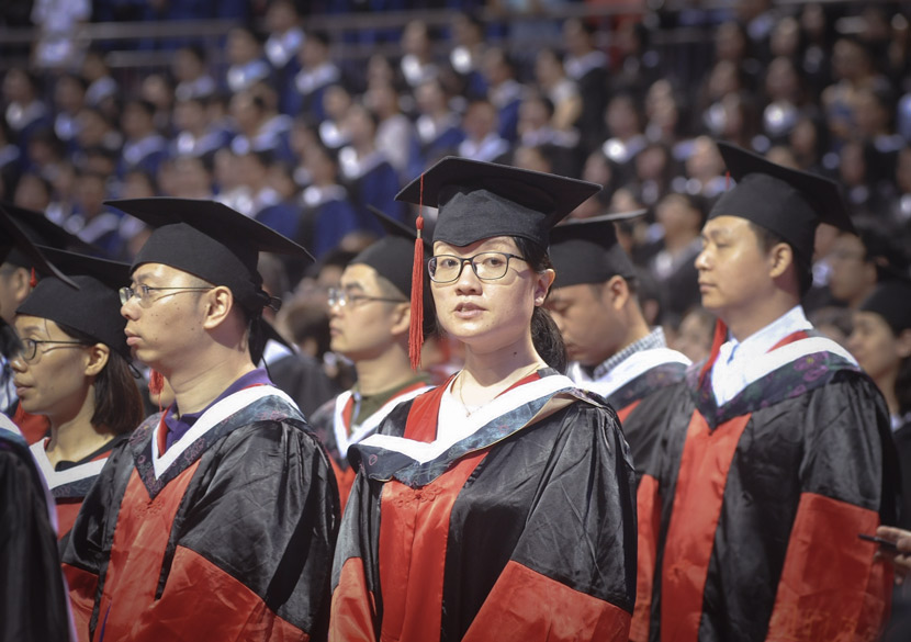 A graduation ceremony for doctorate students in Nanjing, Jiangsu province, June 30, 2018. Qin Huai/VCG