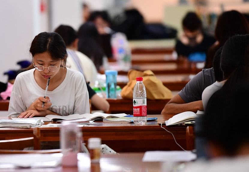 Students study in a university library in Shenyang, Liaoning province, July 5, 2018. VCG