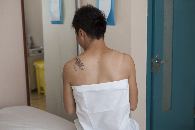A transgender woman prepares to undergo a sex reassignment surgery in Dehui, Jilin province, Sept. 22, 2015. VCG