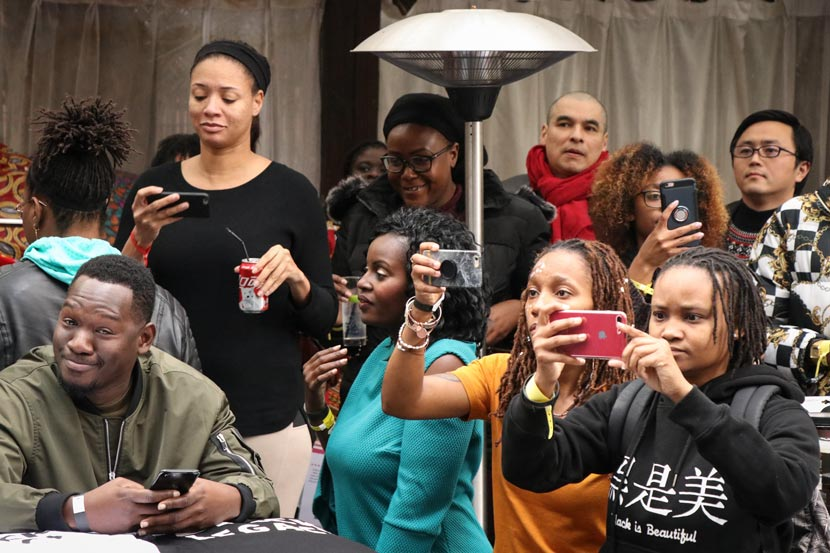 Spectators watch a local rapper perform at Black Expo in Shanghai, Nov. 24, 2018. Kenrick Davis/Sixth Tone