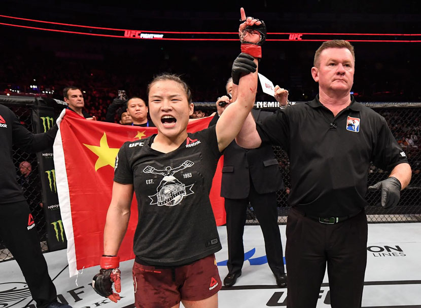 Chinese mixed martial artist Zhang Weili celebrates after her victory at UFC's first-ever event in Beijing, Nov. 24, 2018. Courtesy of UFC
