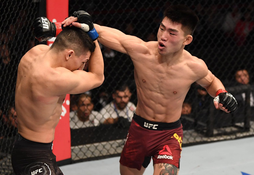 American mixed martial artist Vince Morales protects himself from a punch thrown by his Chinese opponent, Song Yadong, at a UFC Fight Night event in Beijing, Nov. 24, 2018. Courtesy of UFC