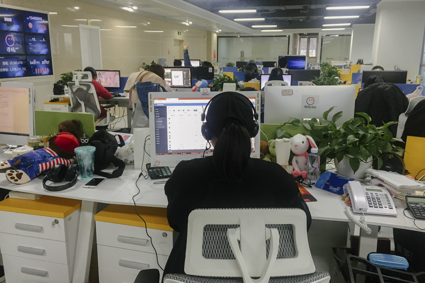 Yuwan's content moderators inspect voice messages in their office in Guiyang, Guizhou province, Oct. 25, 2018. Qian Zhecheng/Sixth Tone