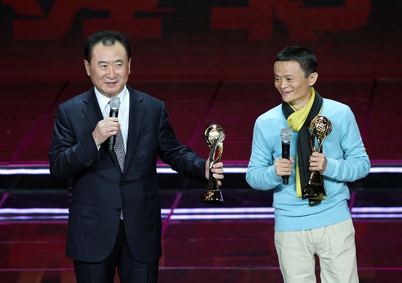 Wang Jianlin (left) and Jack Ma speak onstage at the ceremony for CCTV's 2012 China Economic Person of the Year award in Beijing, Dec. 12, 2012. VCG
