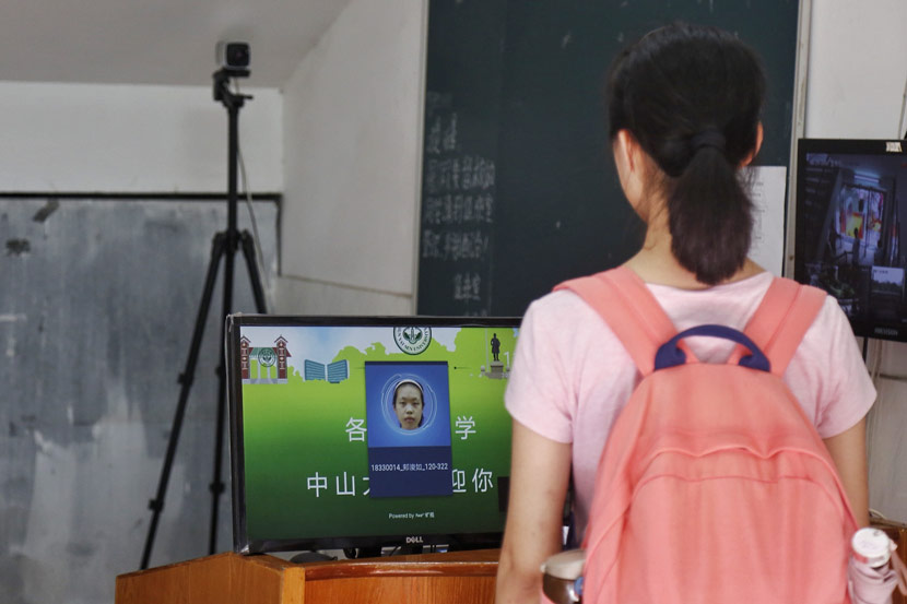 A student has her face scanned before entering a university dormitory in Guangzhou, Guangdong province, Aug. 29, 2018. He Yushuai/Southern Metropolis Daily/VCG