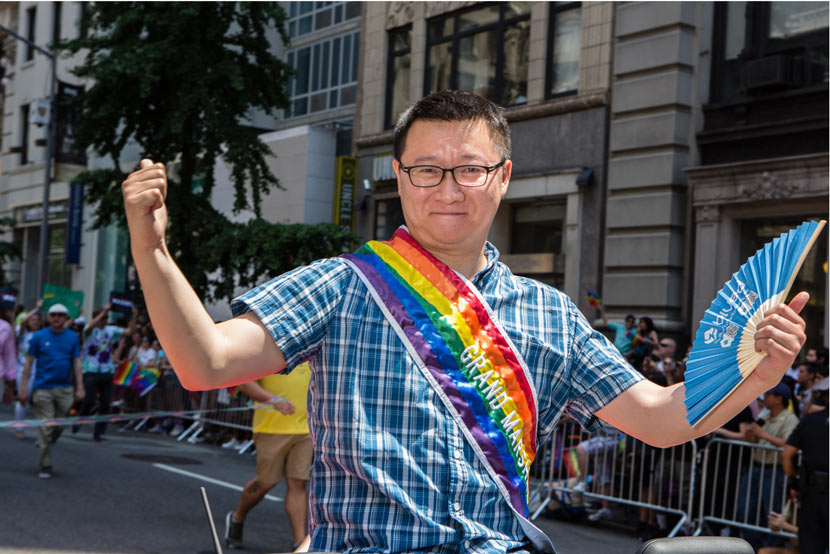 Ma Baoli, founder of Blued's parent company, poses for a photo during a Pride march in New York on June 25, 2017. Ed Lefkowicz / VW Pics / IC