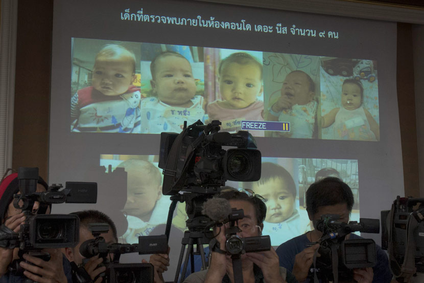 Thailand police display pictures of surrogate babies connected with a surrogacy scandal at the police headquarters in Chonburi, Thailand, Aug. 12, 2014. A multinational investigation found that a 24-year-old Japanese businessman has 16 surrogate babies and an alleged desire to father hundreds more. Sakchai Lalit/AP Photo/IC
