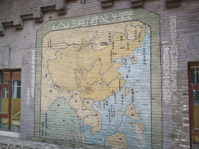 """The 1929 mural """"Give the Mountains and Rivers Back to Me,"""" which depicts the fraught geopolitics of the period, can still be seen on the walls of a Russian-built military camp in Changchun, Jilin province, May 27, 2018. Courtesy of Ma Te"""