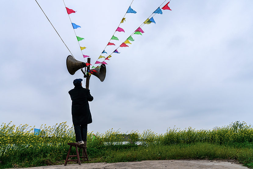 A villager checks the village loudspeakers before a temple fair in Zhouze Village, Xinghua, Jiangsu province, April 5, 2018. Zhou Xiaosong/VCG