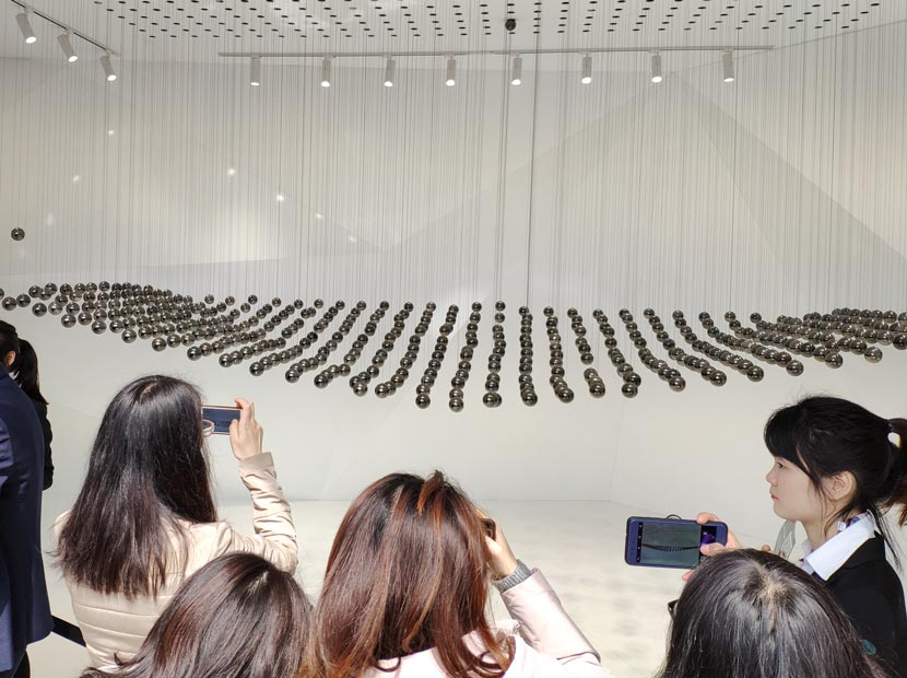 Visitors take photos of an art installation from luxury automaker Lamborghini during the annual Design Shanghai exhibition, March 6, 2019. Kenrick Davis/Sixth Tone