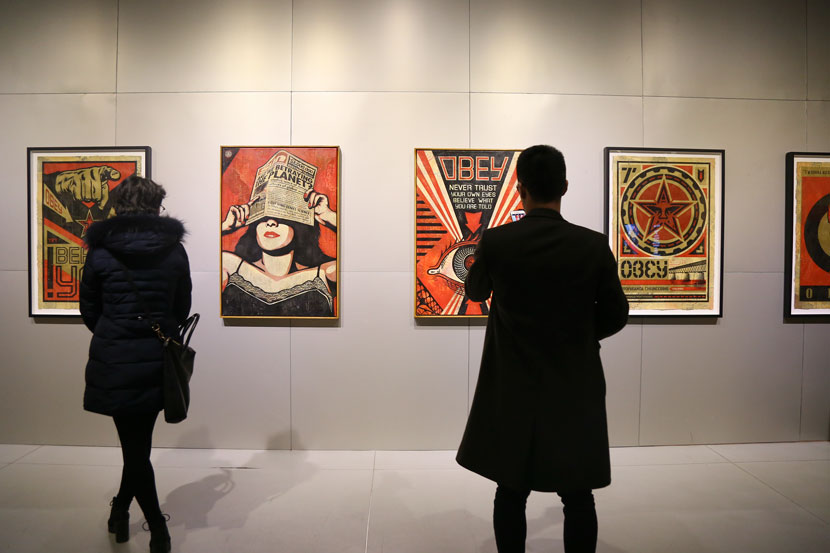 "Visitors take in works by Shepard Fairey at the ""Post Contemporary-Urban Graphic 7019"" exhibition in Shanghai, Jan. 24, 2019. Courtesy of MoCA Shanghai"