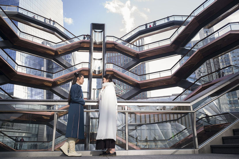 "Two Chinese students in ancient ""hanfu"" clothing pose for a photo in front of the Vessel in New York, March 15, 2019. Liao Pan/CNS/VCG"