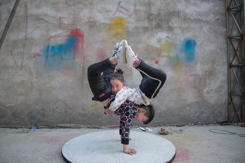 Mengyu and Zhengyang practice acrobatics in Bozhou, Anhui province, March 22, 2019. Shi Yangkun/Sixth Tone