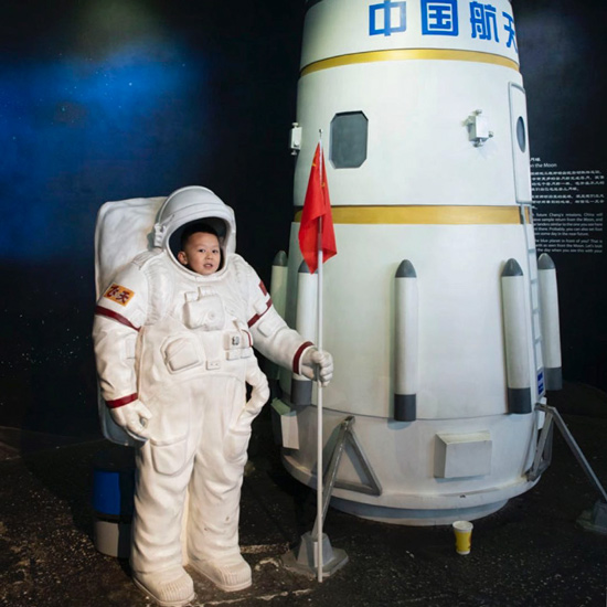 A boy poses for a photo at the Beijing Planetarium in Beijing, March 30, 2019. Matjaz Tancic for Sixth Tone