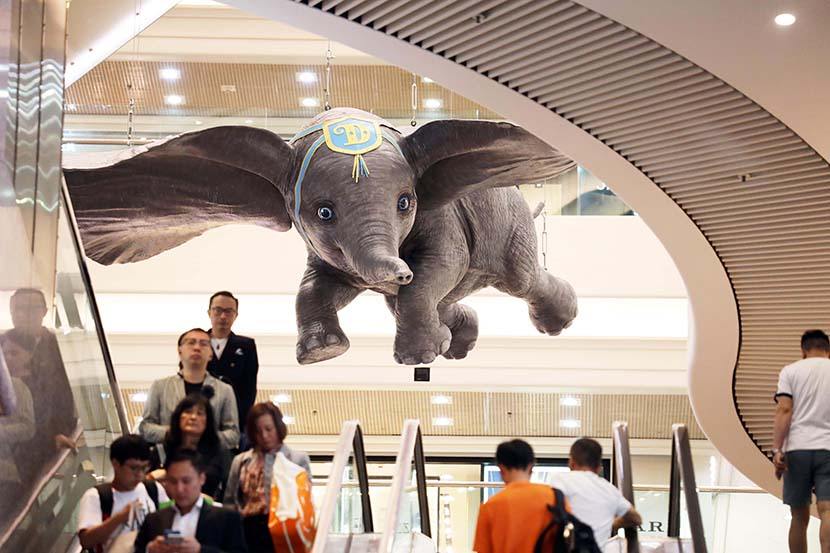 "Visitors walk through an exhibition themed around Disney's ""Dumbo"" at Times Square in Hong Kong, April 18, 2019. Hong Shaokui/China News Service/VCG"