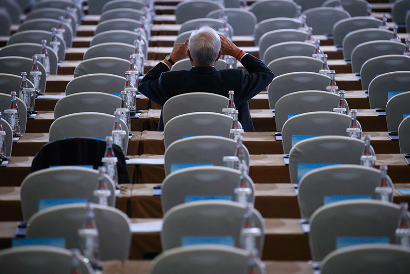 A participant of the second Belt and Road Forum for International Cooperation takes pictures from the seats before the opening ceremony in Beijing, April 26, 2019. How Hwee Young/EPA/IC